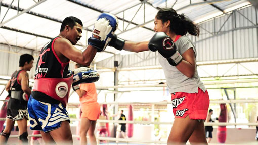 father and daughter training muay thai